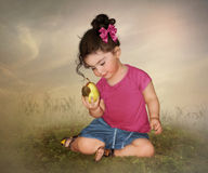 Little girl with pear Royalty Free Stock Image