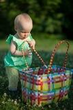 Little girl peeks into bag Stock Photos