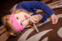 Little girl with a pen Royalty Free Stock Photo