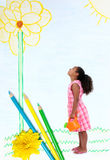 Little Girl in Pencil Drawn Garden. Photograph of girl standing in pencil drawn garden with watering can Royalty Free Stock Images