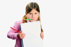 Little  girl with pencil in her mouth and drawing pad Stock Images