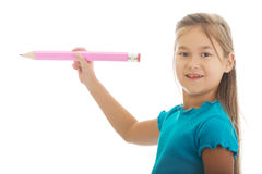 Little girl with a pencil Royalty Free Stock Image