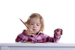 Little girl with pencils Stock Image