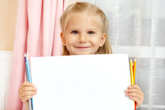 Little girl with pencils royalty free stock photo