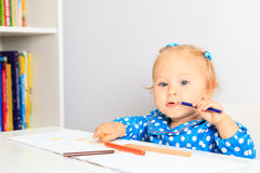 Little girl with pencils Stock Photography