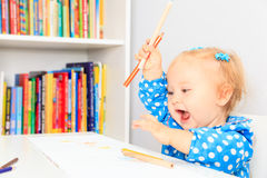 Little girl with pencils Royalty Free Stock Photos