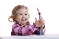 Little girl with pencils at her desk Royalty Free Stock Images