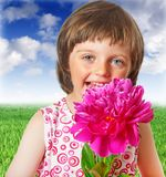 Little girl with  peony flower Stock Photography