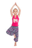 Little girl performs gymnastic exercise. European little girl performs gymnastic exercise in Thai dress. Girl is six years old Stock Photography