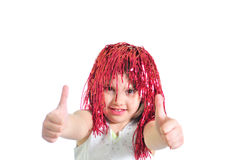Little girl in periwig. Giving OK Royalty Free Stock Image
