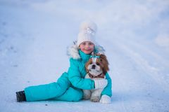 Little girl with pet dog for a walk stock images