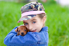 Little girl with pet puppy mascot mini pinscher Stock Photos