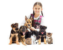 Little girl and pets royalty free stock photography