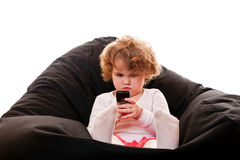 Little girl with phone Stock Photos