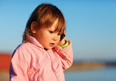 Little girl with  phone Stock Images