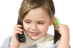 Little girl with phone. The beautiful little girl Speaks by phone and smiles on white background close up Stock Image