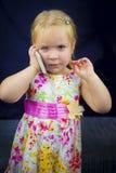 Little girl on the phone Stock Photos
