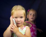 Little girl on the phone Stock Photo