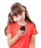 Little girl with a phone in his hand. Little girl picking up a mobile phone number Stock Images