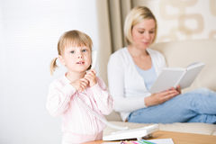 Little girl on phone in living room Stock Photo