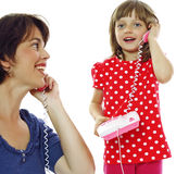 Little girl phone with mother Royalty Free Stock Photography