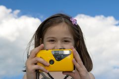 Little girl with photo camera Royalty Free Stock Photo