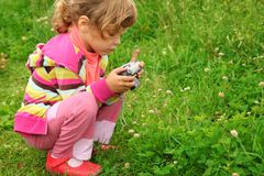 Little girl with photo camera outdoor Stock Photography