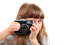 Little Girl with Photo Camera Stock Image