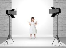 Little girl in photo studio Stock Photo