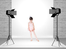 Little girl in photo studio Royalty Free Stock Images