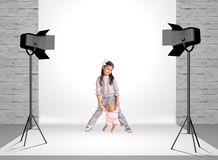 Little girl in photo studio Stock Photo