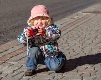 The little girl-photographer Stock Photo
