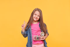Little girl photographer holding a retro camera Royalty Free Stock Images
