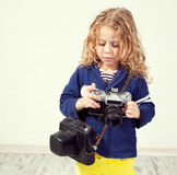 Little girl photographing Stock Photos