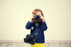 Little girl photographing. Child with camera. Little girl photographing Royalty Free Stock Image