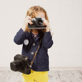 Little girl photographing Royalty Free Stock Photo