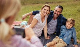 Free Little Girl Photographing Family During Picnic At Park Stock Images - 138366784