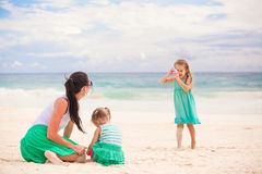 Little girl photographs her mother and little Royalty Free Stock Image