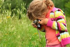 Little girl  photographs outdoor Stock Photo