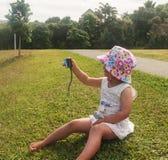 Little girl photographs Stock Image