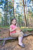 Little girl pick up mushrooms in forest Royalty Free Stock Photos