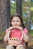 Little girl pick up mushrooms in forest stock images