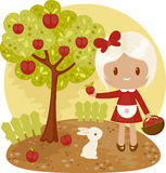 Little girl picking apples from apple tree Stock Images