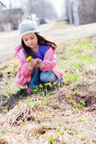 Little girl picking bunch of flowers Stock Images