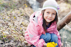 Little girl picking bunch Stock Images