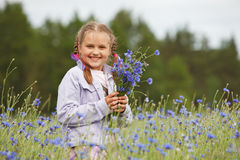 Little girl picking flowers Royalty Free Stock Photos
