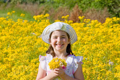 Little Girl Picking Flowers. Girl Picking Flowers in a Field Royalty Free Stock Image