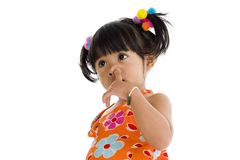 Little girl picking her nose Royalty Free Stock Image