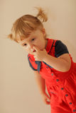 Little girl picking her nose Stock Image