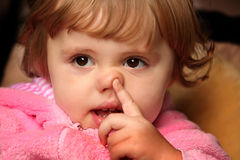 Little girl picking her nose Royalty Free Stock Photography